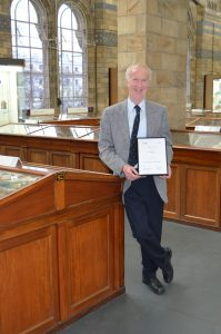 Roy Starkey, winner of the Marsh Award for Mineralogy (2016) in the Mineral Gallery at the NHM, London. Photo © Mary Starkey.